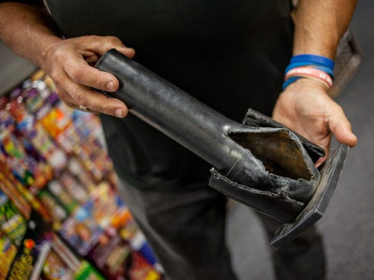 Roger Vargo Sr. shows a mortar tube that had a shell loaded incorrectly Thursday, June 29, 2017 at R&R Fireworks in Port Huron Township. They use the damaged tube to educate customers about the correct, safe way to use fireworks.