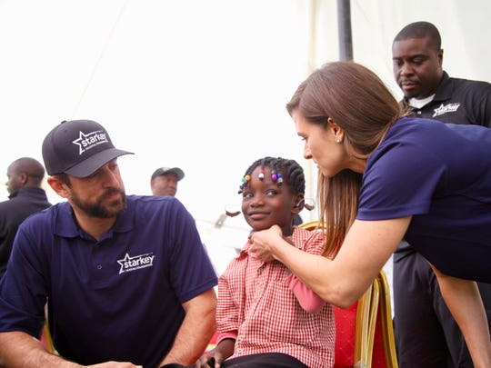 Aaron Rodgers and Danica Patrick recently visited Lusaka, Zambia, in Africa as part of a mission with the Starkey Hearing Foundation to help fit people with hearing aids.