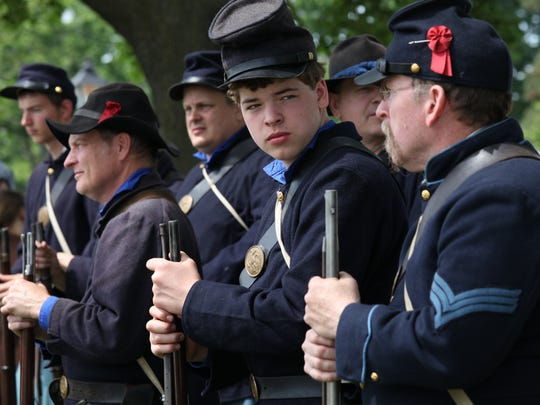 Re-enactors portraying Union and Confederate troops