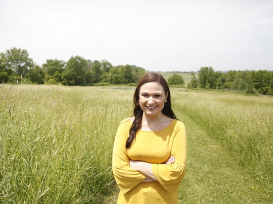Abby Finkenauer near the pond at her parent's house the day after she won the Democratic primary in Iowa's 1st Congressional District. She will now face Rod Blum in the general election.