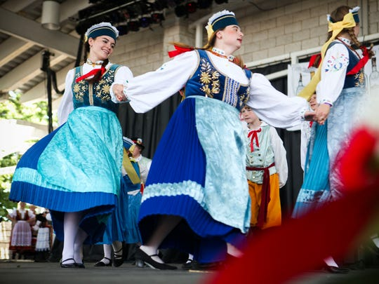 Traditional Polish folk dances took center stage at the Summerfest grounds for Polish Fest 2012 which runs from June 15-17, 2012. One of the largest Polish festivals in the nation, it attracts Polish Americans from all over Wisconsin and Illinios to celebrate Polish culture through music, the arts, food and entertainment.