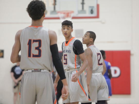 Class of 2021 guard Max Christie (5) talks with teammate Isaiah Barnes (13) during a game Friday at the NY2LA Summer Jam.
