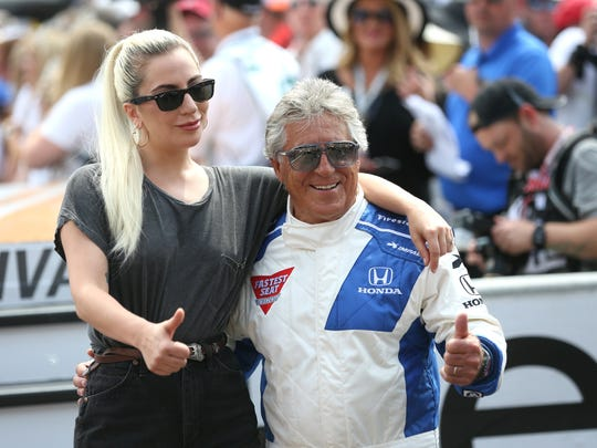 Singer and actress Lady Gaga takes a photograph with