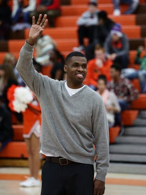 Hall of Fame guard Melvin Selmon flashes his trademark smile while being introduced to fans before last Friday's high school game at Mansfield Senior.