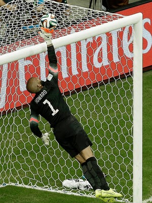 United States' goalkeeper Tim Howard deflects the ball over the crossbar during the World Cup round of 16 soccer match between Belgium and the USA at the Arena Fonte Nova in Salvador, Brazil, Tuesday, July 1, 2014. (AP Photo/Themba Hadebe)