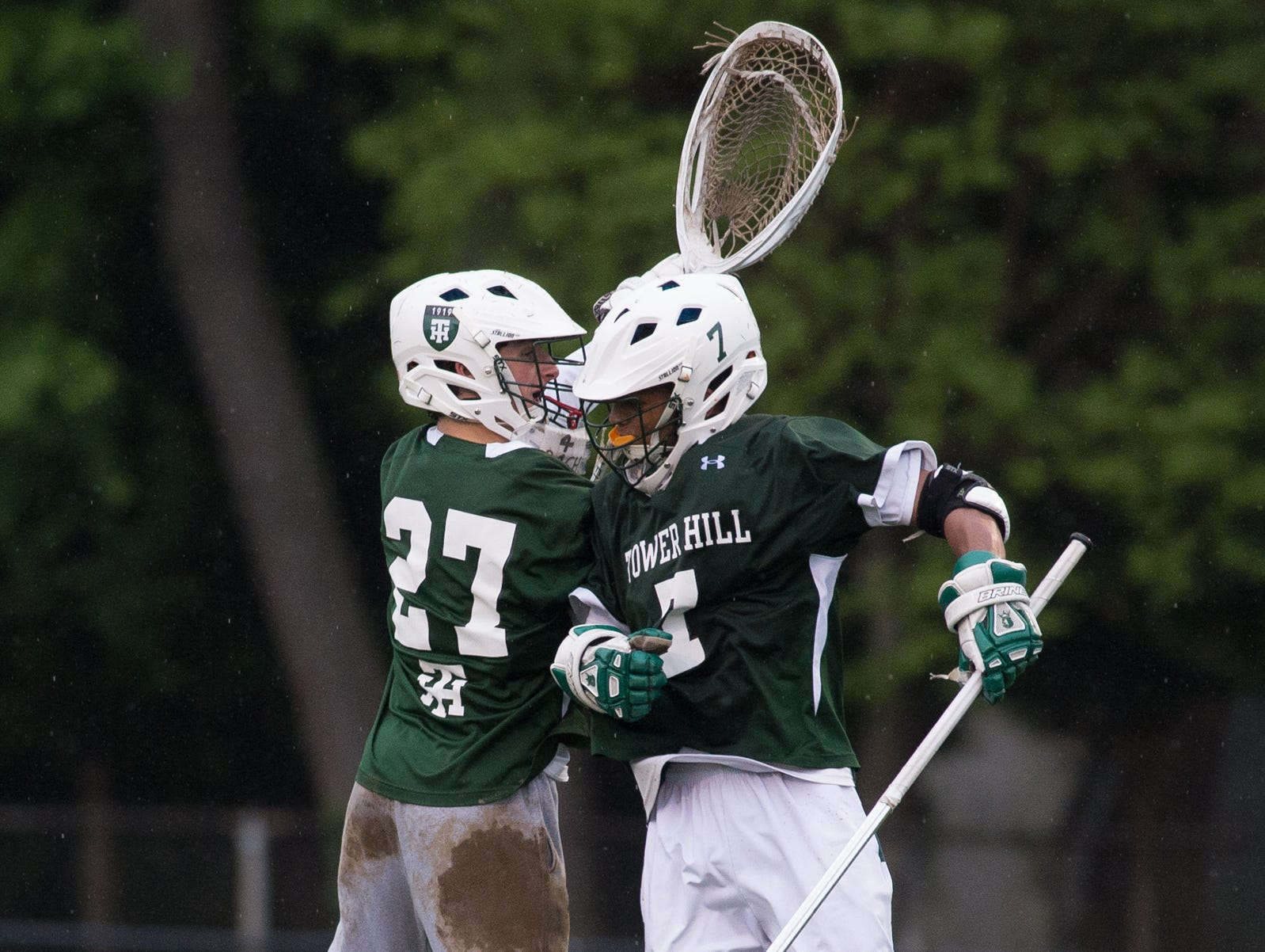 Tower Hill's Michael Gianforcaro (27), left and teammate Kevin Turner (7) jump into the air, congratulating each other, after their 11-9 win over Caesar Rodney.