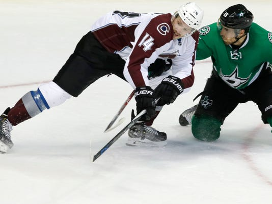 Colorado Avalanche left wing Blake Comeau (14) and Dallas Stars defenseman Patrik Nemeth (15) vie for control of the puck during the second period of an NHL hockey game in Dallas, Thursday, Nov. 17, 2016. (AP Photo/LM Otero)
