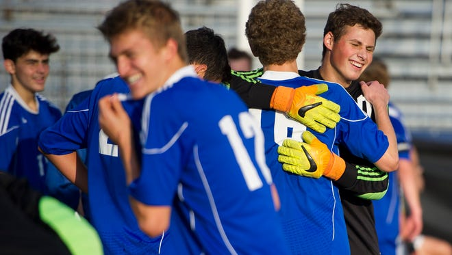 Memorial's Noah Evans (1) celebrates with Memorial's Matthew Burkhart (16) during the Class 2A state championship at Carroll Stadium in Indianapolis, Saturday, Oct. 29, 2016. Memorial beat Chesterton 2-1.