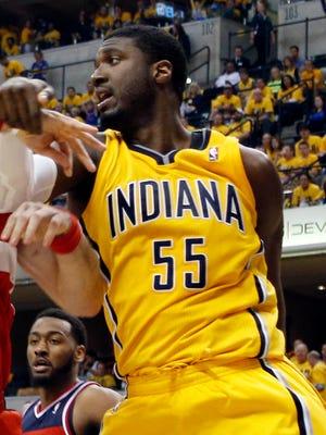 Pacers center Roy Hibbert battles Wizards center Marcin Gortat for position in Game 1.