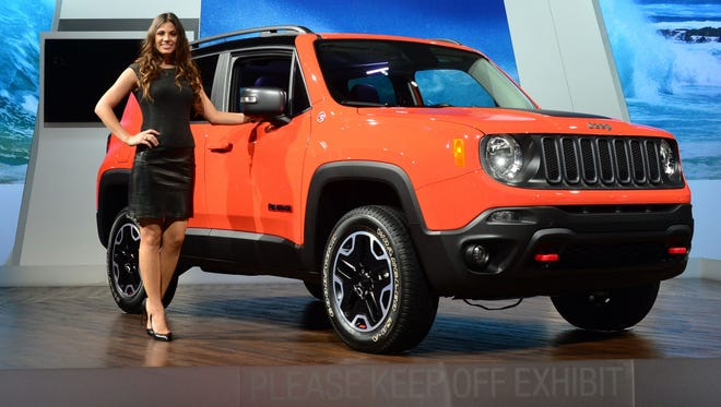 A model poses beside the all-new 2015 Jeep Renegade on display at the Los Angeles Auto Show last year
