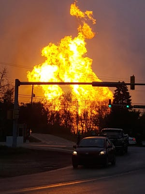 In this photo taken by Salem Township Supervisor Kerry Jobe, flames erupt during a natural gas explosion at a pipeline complex in Greensburg, Pa., Friday, April 29, 2016. The explosion, which burned one person, caused flames to shoot above nearby treetops in the largely rural Salem Township, about 30 miles east of Pittsburgh, and prompted authorities to evacuate businesses nearby. The cause of the blast wasn't immediately clear. (Kerry Jobe via AP)