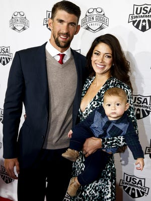 Michael Phelps, wife Nicole Johnson and their son Boomer arrive to the 2016 Golden Goggles Awards at the Marriott Marquis Hotel on November 21, 2016 in New York City.