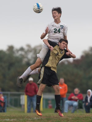 Colts Neck's Connor Smith jumps high for a header over the top of Southern's Joseph Kiernan. Southern Regional Boys Soccer vs Colts Neck in SCT Tourney play in Colts Neck NJ on October 20, 2016.