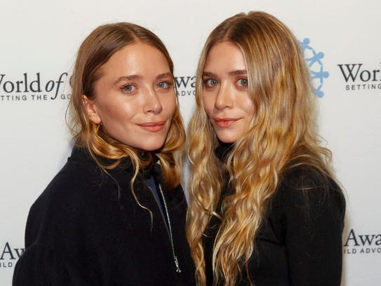 Mary-Kate Olsen, left, and Ashley Olsen attend the
