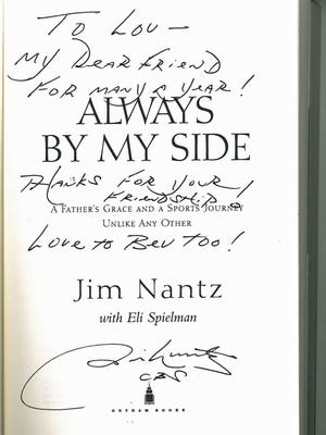 Jim Nantz autographed a book specially for Lou Gerber after the two became friends many years ago.