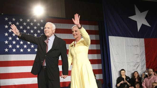 Republican presidential hopeful, Sen. John McCain, R-Ariz., reacts with his wife Cindy as they arrive on stage at his primary election watch party in Dallas, Texas, on March 4, 2008. McCain clinched the Republican presidential nomination.