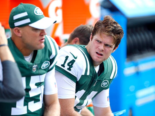 Sep 16, 2018; East Rutherford, NJ, USA; New York Jets quarterback Sam Darnold (14) talks to New York Jets quarterback Josh McCown (15) after a turnover against the Miami Dolphins during second half at MetLife Stadium. Mandatory Credit: Noah K. Murray-USA TODAY Sports