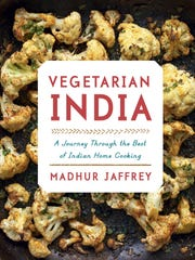 """This image provided by Alfred A. Knopf shows the cover for the book """"Vegetarian India"""" by Madhur Jaffrey. Jaffrey's newest book, """"Vegetarian India: A Journey Through the Best of Indian Home Cooking,"""" will be released in October. (Alfred A. Knopf via AP)"""