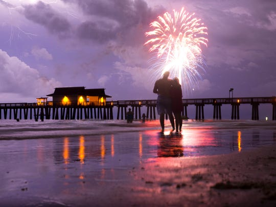 Hundreds gather to watch the Fourth of July fireworks celebration at Naples Pier on July 4, 2016.