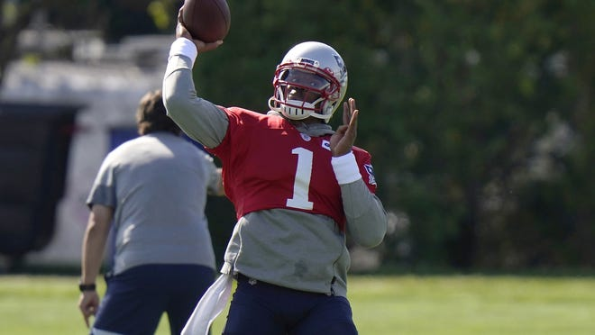 New England's Cam Newton throws the ball during Wednesday's practice.