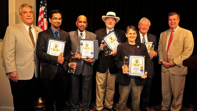 Mayor Karl Dean, right, and Tom Negri, interim director of the Metro Human Relations Commission, left, pose for a photograph with Gail Kerr HRCules Award recipients Rashed Fakhruddin, second from left, Neal Darby, Les Kerr, Abby Rubenfeld and Dr. Michael Spalding during the ceremony at City Hall in Nashville on Monday, July 21, 2014.