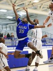 Fighting for a rebound are Salem's Jordan Ingram (10)