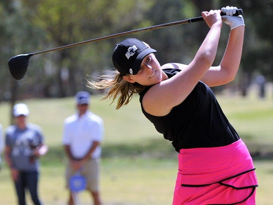 Big Spring's Abbey Bryan tees off from No. 1 during a playoff for second place in the Region I-4A tournament at Shadow Hills Golf Course in Lubbock on Thursday. Bryan finished third to qualify for the state tournament