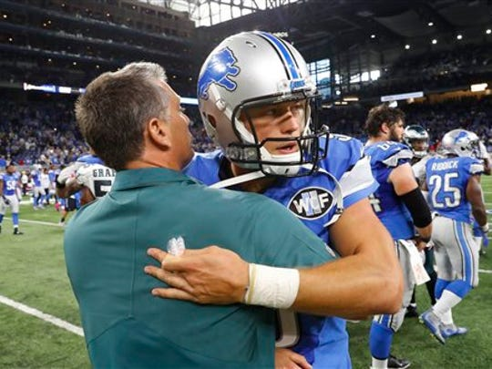 Detroit Lions quarterback Matthew Stafford greets former Lions head coach and current Philadelphia Eagles defensive coordinator Jim Schwartz during the second half of an NFL football game, Sunday, Oct. 9, 2016, in Detroit. (AP Photo/Paul Sancya)