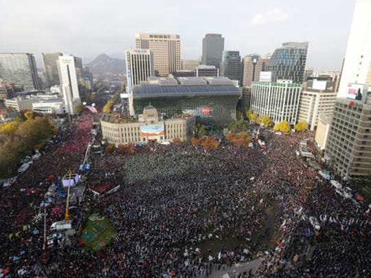 FILE - In this Saturday, Nov. 12, 2016, file photo, protesters stage a rally calling for South Korean President Park Geun-hye to step down in Seoul, South Korea. South Korea is seeing its biggest wave of street demonstrations in decades but nobody is sure how many people are taking to the streets each week. At first media relied on two sources - the police and the organizer. But they have been accused of underestimating or overestimating the crowds in the previous four Saturdays.