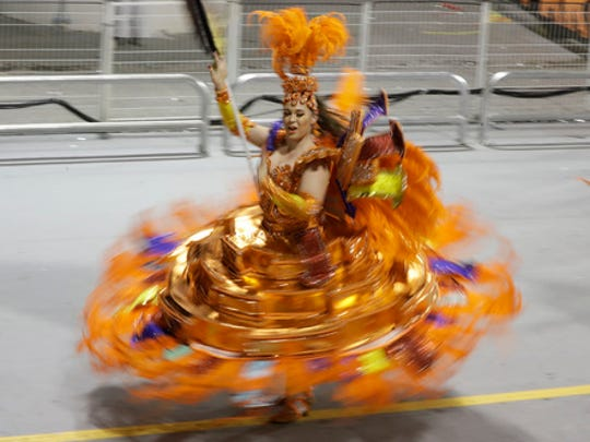 A dancer from the Gavioes da Fiel samba school performs during a carnival parade in Sao Paulo, Brazil, early Saturday, Feb. 25, 2017.