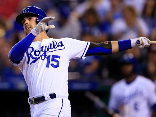 Kansas City Royals' Whit Merrifield watches a solo home run off Tampa Bay Rays starting pitcher Alex Cobb during the third inning of a baseball game at Kauffman Stadium in Kansas City, Mo., Tuesday, Aug. 29, 2017. (AP Photo/Orlin Wagner)