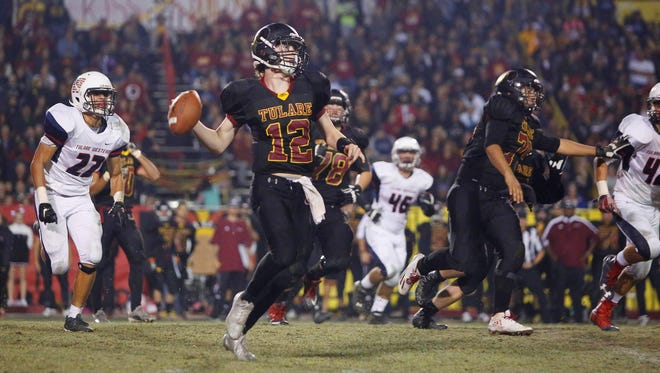 Tulare Union quarterback Nathan Lamb looks to past against Tulare Western in last year's Bell Game.