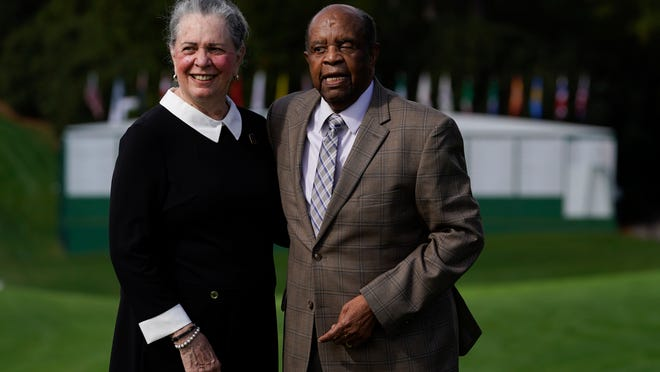 Lee Elder and his wife Sharon posed for a picture on the first tee at the Masters golf tournament Monday, Nov. 9, 2020, in Augusta, Ga. Fred Ridley, Chairman of Augusta National Golf Club, announced today that Lee Elder, the first Black man to compete in the Masters Tournament 45 years ago, will be honored by establishing scholarships in his name and inviting him to be an Honorary Starter for the 2021 Masters.