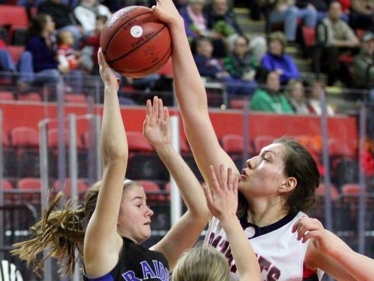 Binghamton's Jodi-Marie Ramil blocks a shot by Tatum