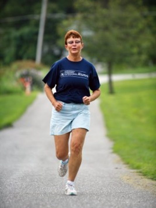Norma Beyer runs near her home in Dover Township in July 2012. Norma Beyer, then 59, has had ovarian cancer since 2007, yet she hasn't let it stop her from living her life. (Daily Record/Sunday News -- Paul Kuehnel)