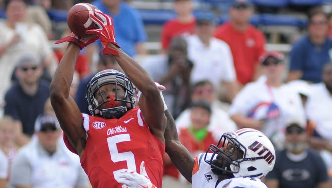 Wide receiver DaMarkus Lodge (5) catches a touchdown pass in front of Tennessee Martin defensive back Jaquille White (4) at Vaught-Hemingway Stadium. The Rebels won 76 -  3. Mandatory Credit: Justin Ford-USA TODAY Sports