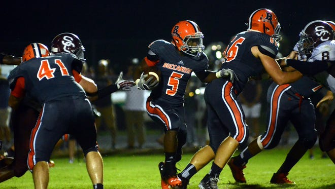 Beech junior running back Rodrick Napper finds a hole against Station Camp on Friday. Napper rushed for 153 yards and two touchdowns on 24 carries in the Buccaneers' 26-14 victory.