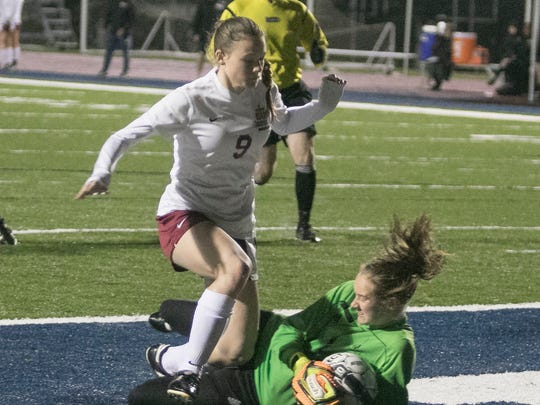 Peyton St. Pierre has her shot blocked by Ben Franklin's goalie during play in the first half as STM hosts Ben Franklin on Friday night in a semifinal game.