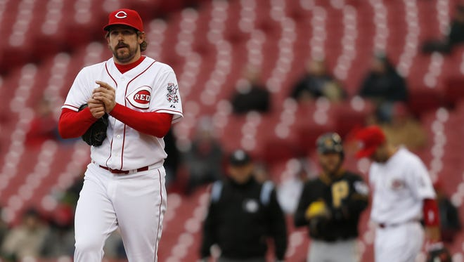 Cincinnati Reds relief pitcher Sam LeCure (63) reacts after giving up a game-winning base hit to Pittsburgh Pirates catcher Russell Martin (55) in the seventh inning, driving in center fielder Andrew McCutchen (22).
