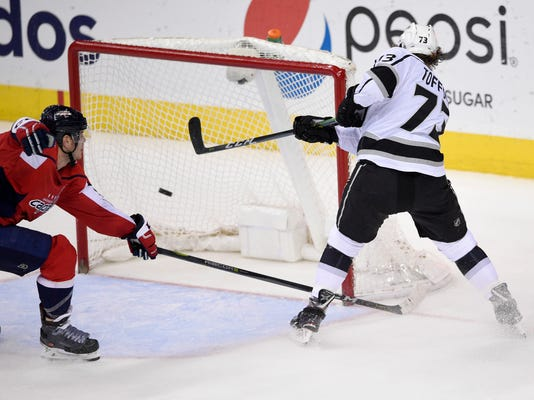 Los Angeles Kings center Tyler Toffoli (73) scores an empty-net goal against the Washington Capitals during the third period of an NHL hockey game, Thursday, Nov. 30, 2017, in Washington. The Kings won 5-2. (AP Photo/Nick Wass)