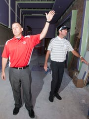 Blue Wahoos president Jonathan Griffin and Bubba Watson in May 2016 as they surveyed the building that would become Bubba's Sweet Spot on Palafox Street.