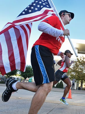Members of Team RWB run in the inaugural Brookshire's and Super 1 Foods Heroes Run in downtown Shreveport.