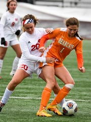 Mater Dei defender Emma Peerman (20) battles with a Wheeler attacker for the ball in the state championship game last year. The Wildcats face the Bearcats in a repeat of the Class 1A state finals.
