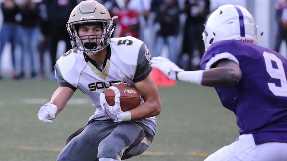 Clarkstown South's Joey Zingaro is defended by Storm Jones during the New Rochelle vs. Clarkstown South football game at Fosina Field in Flowers Park in New Rochelle, Sept. 8, 2017