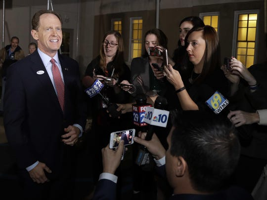 Sen. Pat Toomey, R-Pa., speaks to the media after voting at the Zion's Evangelical Lutheran Church, Tuesday, Nov. 8, 2016, in Old Zionsville, Pa. (AP Photo/Matt Slocum)