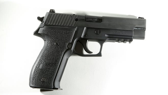 A Sig Sauer 9mm P226 handgun as seen at Second Amendment Sports in Palm Desert, Calif. GunTV, a home shopping channel for guns, will begin broadcasting Friday, April 1, 2016, at 1 a.m. Eastern.