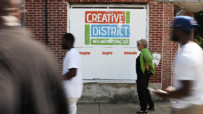 Members of the public tour vacant properties that will be a part of a proposed creative district near the Quaker Hill neighborhood in Wilmington.