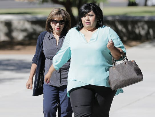 Former EPISD administrator Maria Flores, left, walks