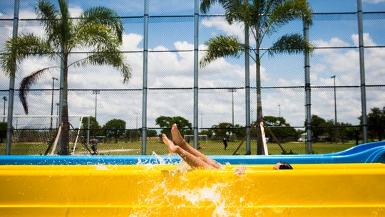 Margarita Mendez, 14, speeds down the waterslide on