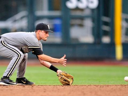 Vanderbilt second baseman Tyler Campbell fields a ground ball hit by Virginia during the third inning in the Game 2 of the College World Series finals at TD Ameritrade Park, Tuesday, June 23, 2015, in Omaha, Neb.
